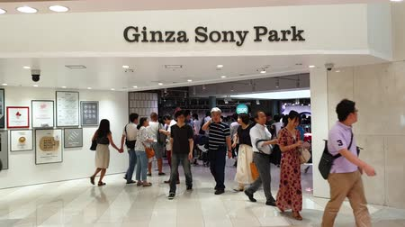 ginza : Tokyo, Japan - August 2018: Entrance of Ginza Sony Park with many unidentified local people and tourists are visiting Stock Footage