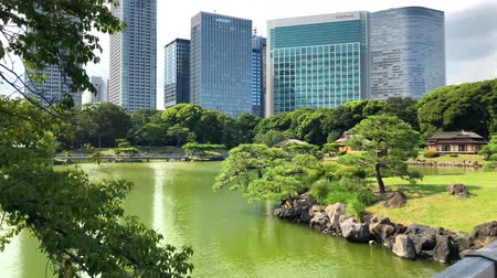 kanto district : Tokyo, Japan - August 2018: Hamarikyu Gardens is a large and attractive landscape garden in Chuo district, Sumida River