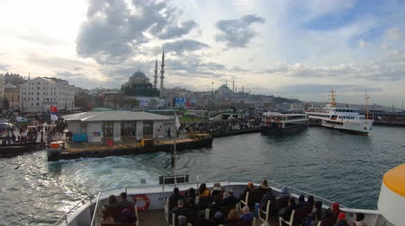 ferryboat : Istanbul, Turkey - December 2018: Ferry departing from Eminonu pier to Uskudar with passengers seated