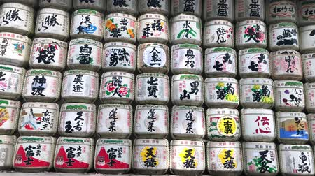 sake : Tokyo, Japan - August 2018: Barrels with sake were donated as a gift to Meiji Shrine from a different Japan breweries. These barrels have got a special name komokaburi.