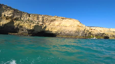 lagos : Natural rock formations at the coastline in Praia da Marinha viewed from popular boat cave tour along Algarve coast, Lagos, Portugal