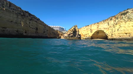 oszlopsor : Natural rock formations at the coastline in Praia da Marinha viewed from popular boat cave tour along Algarve coast, Lagos, Portugal