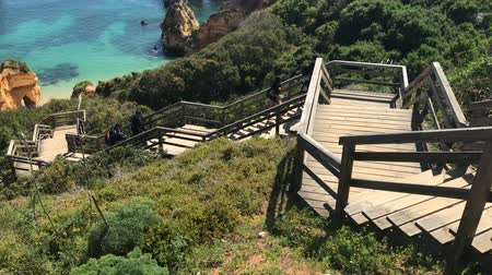 ponta da piedade : Lagos, Portugal - April 2018: Stairs leading to the beautiful sandy beach near Lagos in Ponta da Piedade, Algarve region, Portugal