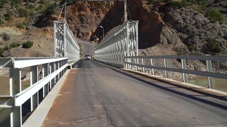 governor : Kemaliye, Turkey - October 2018: Car crossing Recep Yazicioglu bridge on River Euphrates, Erzincan