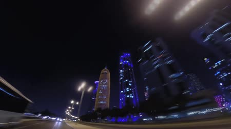 camera rotation : Doha, Qatar -February 2019: Fast paced hyperlapse video of financial centre skyscrapers in Doha, capital and most populous city in Qatar, West Bay, Persian Gulf, Arabian Peninsula, Middle East