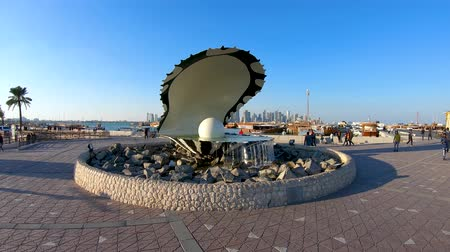 oysters : Doha, Qatar - February 2019: Pearl and oyster fountain landmark monument on the Corniche