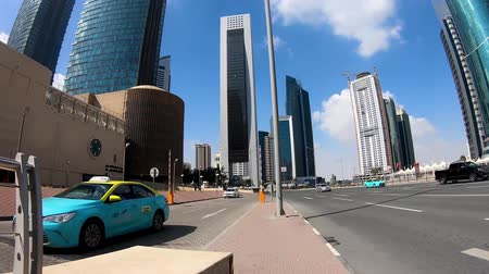 mosque doha : Doha, Qatar - February 2019: Doha finance center hyperlapse of a pedestrian walking in the streets and between skyscrapers