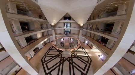corniche : Doha, Qatar - February 2019: Wide angle pan inside Museum of Islamic Art