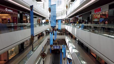 butik : istanbul, Turkey - July 2019: People walking and shopping inside Ozdilek Shopping Mall Stok Video