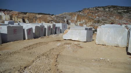 яма : Marmara island, Turkey - June 2019: Huge marble blocks extracted from a marble quarry in Marmara island, Balikesir, Turkey