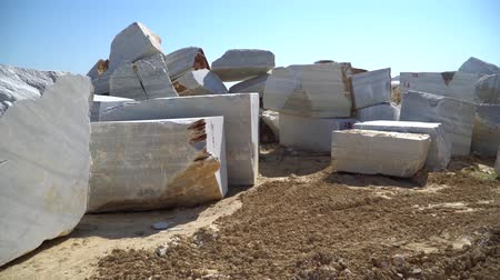 natural resource : Marmara island, Turkey - June 2019: Huge marble blocks extracted from a marble quarry in Marmara island, Balikesir, Turkey