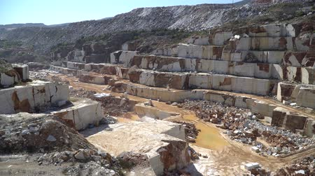 pedreira : Marble quarry pit with rocks and blocks of marble in Marmara island, Balikesir, Turkey Stock Footage