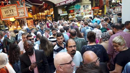 economico : Istanbul, Turkey - October 2019: Crowds of people walking in narrow bazaar roads of Eminonu district, the old city of istanbul near spice bazaar Filmati Stock