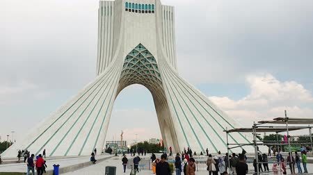 teheran : Tehran, Iran - April 2019: People walking in Azadi square with Azadi Tower in the Iranian capital Tehran