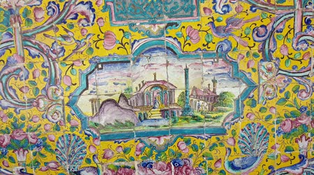イラン : Tehran, Iran - May 2019: Colorful mosaic painting and tiles of Golestan palace, a UNESCO world heritage site