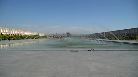 isfahan : Isfahan, Iran - May 2019: Fountains and pond in Isfahan Naqsh-e Jahan Square also called Imam Square Stock Footage