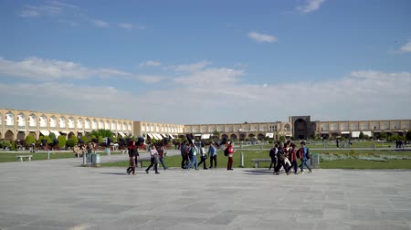 esfahan : Isfahan, Iran - May 2019: Tourists and Iranian people in Isfahan Naqsh-e Jahan Square also called Imam Square
