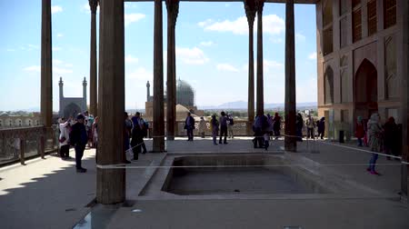 isfahan : Isfahan, Iran - May 2019: The terrace of Aali Qapu Palace with tourists in Isfahan Naqsh-e Jahan Square