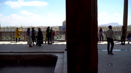 persie : Isfahan, Iran - May 2019: The terrace of Aali Qapu Palace with tourists in Isfahan Naqsh-e Jahan Square