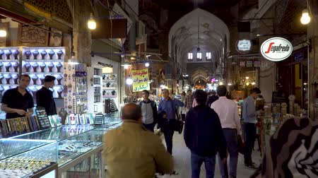 isfahan : Isfahan, Iran - May 2019: Tourists and local people shopping in Bazar Bozorg, also known as the Grand Bazaar, which is a historical market