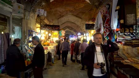 stragan : Isfahan, Iran - May 2019: Tourists and local people shopping in Bazar Bozorg, also known as the Grand Bazaar, which is a historical market