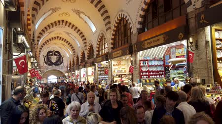 economico : Istanbul, Turkey - October 2019: The shops and crowds of people inside the Egyptian Spice Bazaar of Eminonu district, the old city of istanbul