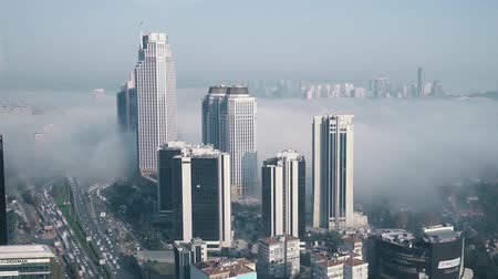 queue : istanbul, Turkey - April 2019: Timelapse of Levent financial district under fog