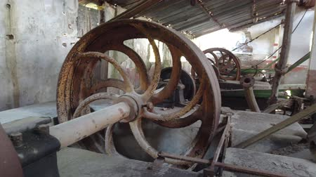 paslanmış : Marmara island, Turkey - October 2019: Rusty equipment in an abandoned old marble quarry factory in Marmara island, Balikesir, Turkey