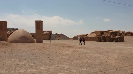 putrefaction : Yazd, Iran - May 2019: Ruins of ritual buildings next to Zoroastrians Dakhmeh Towers of Silence in Yazd city