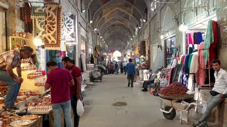 isfahan : Shiraz, Iran - May 2019: Tourists and local people shopping in Vakil Bazaar, also known as the Grand Bazaar Stock Footage