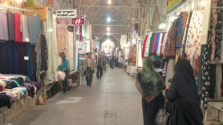 persie : Shiraz, Iran - May 2019: Tourists and local people shopping in Vakil Bazaar, also known as the Grand Bazaar Dostupné videozáznamy