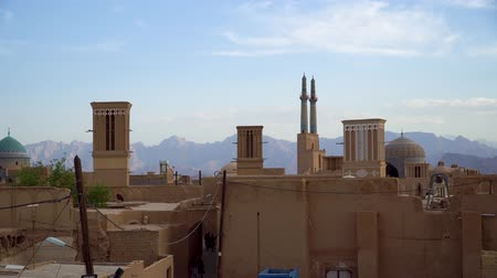 mesquita : Yazd, Iran - May 2019: Yazd cityscape with old brick buildings and badgirs wind catching towers in Yazd, Iran.
