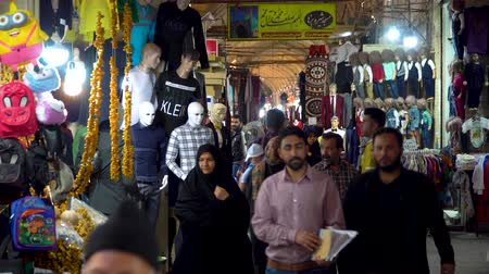el sanatları : Shiraz, Iran - May 2019: Tourists and local people shopping in Vakil Bazaar, also known as the Grand Bazaar Stok Video