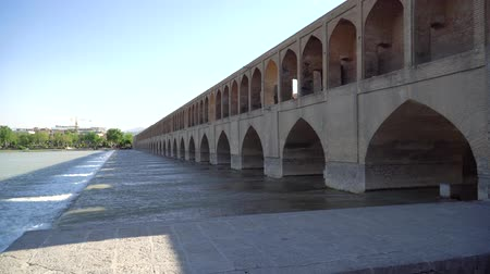 isfahan : Isfahan, Iran - May 2019: Zayandeh river flowing under SioSe Pol or Bridge of 33 arches, one of the oldest bridges of Esfahan and longest bridge on Zayandeh River