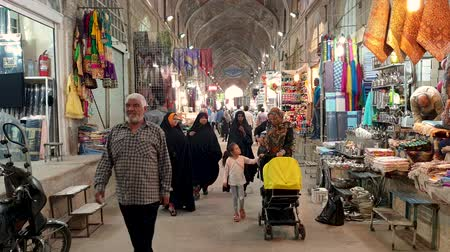 el sanatları : Isfahan, Iran - May 2019: Tourists and local people shopping in Bazar Bozorg, also known as the Grand Bazaar, which is a historical market