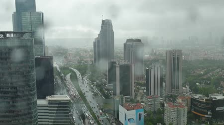 queue : Istanbul, Turkey - April 2019: Time lapse of Levent financial district under rain Stock Footage