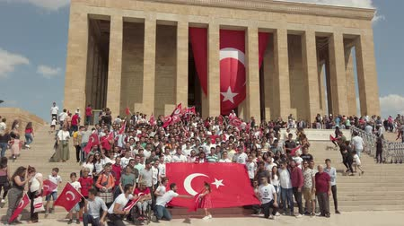 Ankara, Turkey - August 2019: Turkish people with Turkish flags infront of Anitkabir Mausoleum of Ataturk, the Great Leader Ataturk in his grave to convey his love and respect.