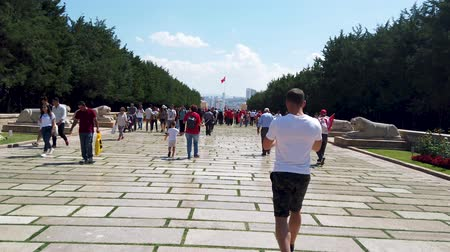 Ankara, Turkey - August 2019: People walk in Road of Lions to reach Anitkabir mausoleum of Mustafa Kemal Ataturk. Many people visit Anitkabir every year.