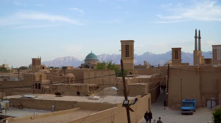 Yazd, Iran - May 2019: Yazd cityscape with old brick buildings and badgirs wind catching towers in Yazd, Iran.