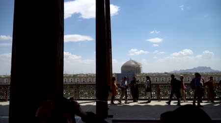 Isfahan, Iran - May 2019: The terrace of Aali Qapu Palace with tourists in Isfahan Naqsh-e Jahan Square