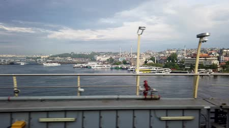 Istanbul, Turkey - December 2019: View from train window while crossing the Halic metro bridge overlooking Golden Horn Стоковые видеозаписи