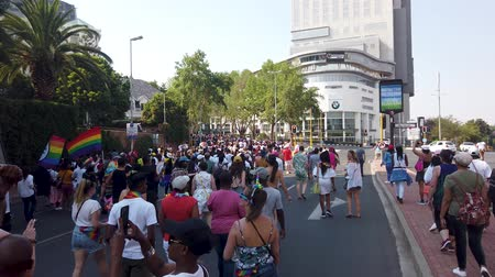 Johannesburg, South Africa - October 2019: Crowded people marching and having fun at Gay pride March Стоковые видеозаписи