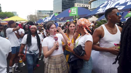 Johannesburg, South Africa - October 2019: Crowded people socializing and drinking at South African Johannesburg Gay Pride March Stock Footage