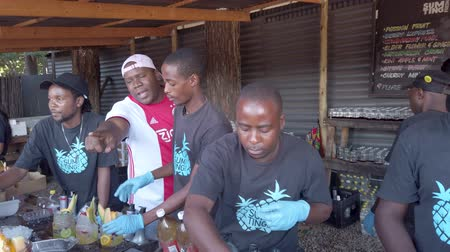Johannesburg, South Africa - October 2019: Group of man preparing and selling local cocktail drink in their stalls in Fourways Farmers Market Стоковые видеозаписи