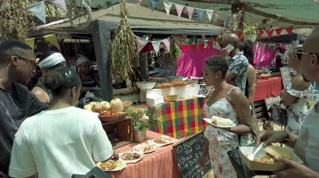 Johannesburg, South Africa - October 2019: People buying and eating local food from stalls in Fourways Farmers Market Vídeos