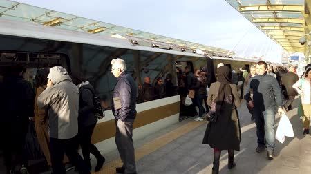 Istanbul, Turkey - December 2019: Commuters boarding the tram at Halic metro station. Busy public transport in Istanbul Стоковые видеозаписи