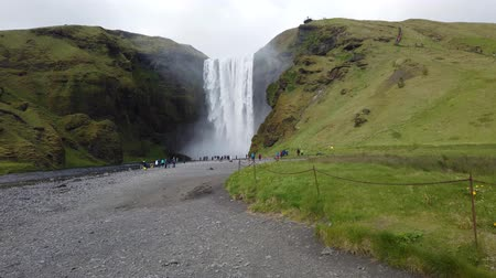 skogafoss : Skogar, Iceland - August 2019: Huge waterfall of Skogafoss with tourists visiting, Skogar, south of Iceland