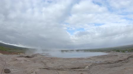 Strokkur geothermal landscape in Iceland with hot water and smoke, Strokkur, Iceland. High concentration of volcanoes is often an advantage in the generation of geothermal energy in Iceland Stock Footage