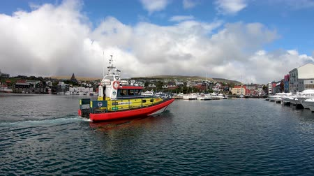 Torshavn, Faroe Islands - August 2019: A boat sailing into Torshavn marina harbour on Faroe islands. Vídeos