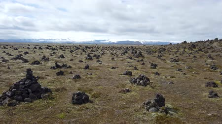 good fortune : Good luck cairns made of stones on a lava field called Laufskalavarda in southern Iceland